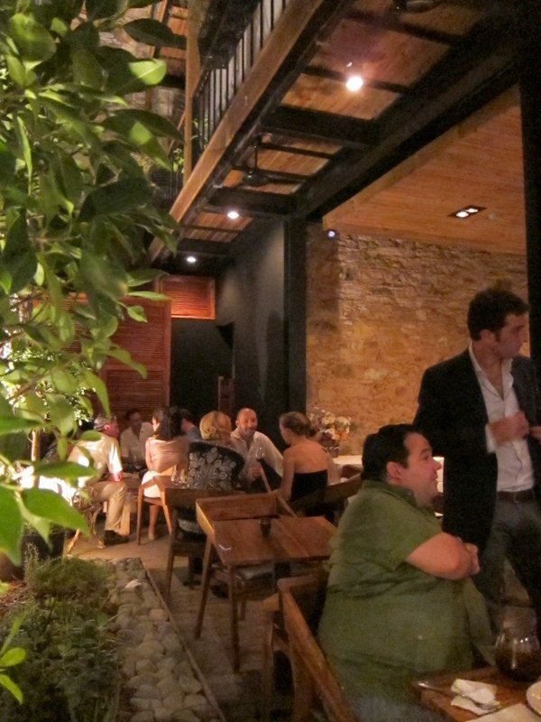 Patrons enjoy drinks while waiting for entrees at Casco Viejo's newestrestaurant L'Osteria