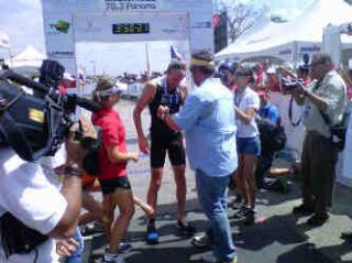 Panama Ironman winner 2012 is congratulated at the finish line.