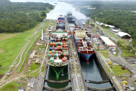 Container ships pass through the Gatun Locks of the Panama Canal