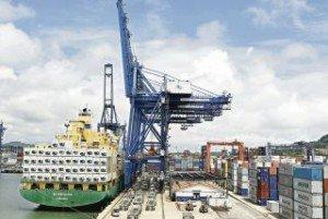 Panama container ship in Colon loads cargo.