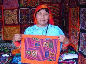 A Guna woman displays mola art she has crafted.
